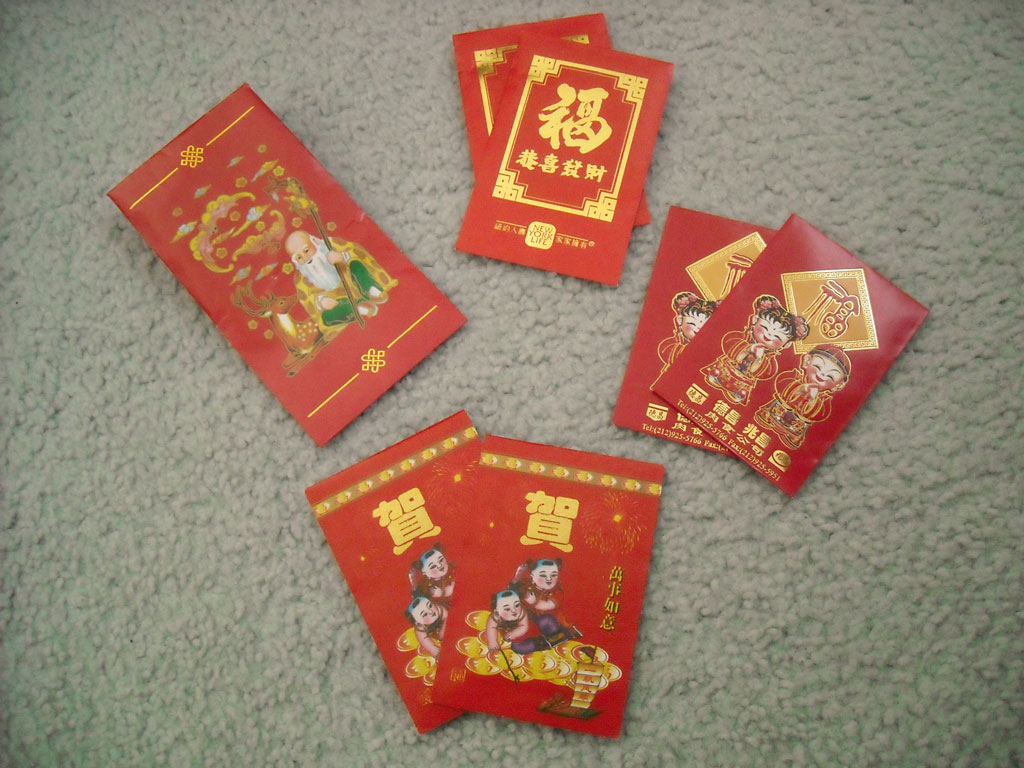 Red Envelopes ward off evil spirits and fill one's wallet